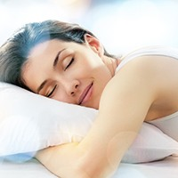 Woman sleeping without being interrupted by sleep apnea