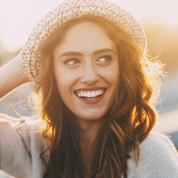 Owings Mills Cosmetic Dentist Smiling woman with sun hat
