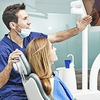Dentist and patient looking at virtual smile design
