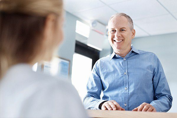 man scheduling dental appointment