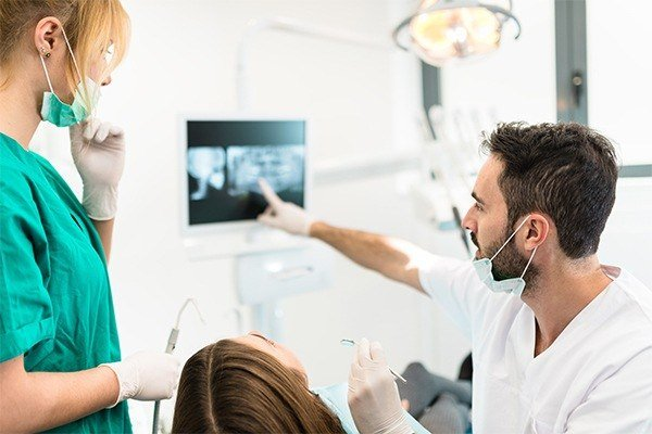 Dentist pointing at x-ray