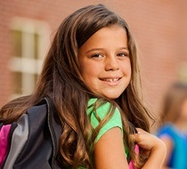 young girl wearing a backpack