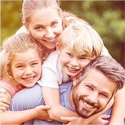 Owings Mills Preventive Dentistry Smiling mother father and two children