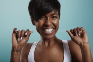 woman following the oral hygiene best practices